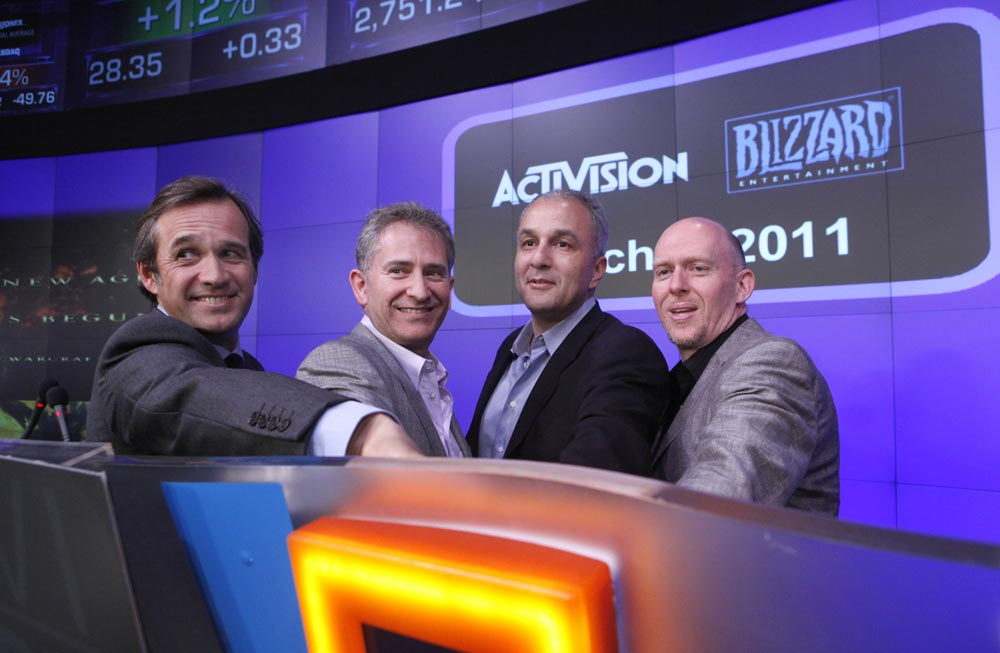 From left, Activision COO Thomas Tippl and Blizzard Entertainment co-founders Mike Morhaime, Allen Adham and Frank Pearce celebrate Blizzard's twentieth anniversary by ringing the closing bell at the NASDAQ Marketsite, Monday, March 7, 2011 in New York. (Jason DeCrow/AP Images for Blizzard Entertainment)